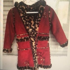 The children place red girl coat with leopard